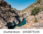 ancient arched genoese stone... | Shutterstock . vector #1043875144