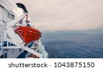 life boat with blue sea in the... | Shutterstock . vector #1043875150