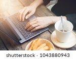 hands woman on laptop keyboard... | Shutterstock . vector #1043880943