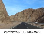 road in the mountains of dahab. ... | Shutterstock . vector #1043895520