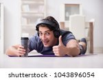 man doing sports at home and... | Shutterstock . vector #1043896054