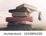 conceptual image a brave woman climbing a pile of books to reach the top