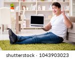 man working on laptop at home... | Shutterstock . vector #1043903023