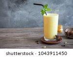 turmeric lassie or lassi in... | Shutterstock . vector #1043911450