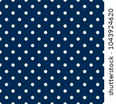 white polka dots on navy blue... | Shutterstock .eps vector #1043924620