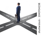 young businessman at crossroads ...   Shutterstock . vector #1043934238