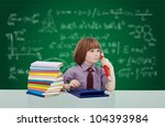 Boy genius thinking - young child in school learning various subjects - stock photo