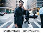 positive young businessman... | Shutterstock . vector #1043939848