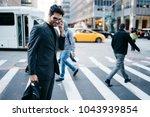 cheerful businessman of... | Shutterstock . vector #1043939854
