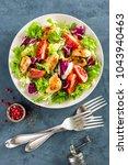 fresh vegetable salad bowl of... | Shutterstock . vector #1043940463