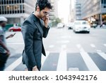 side view of young proud ceo... | Shutterstock . vector #1043942176