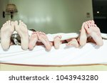 stylishly beautiful legs on bed ... | Shutterstock . vector #1043943280