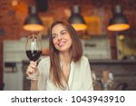 smiling girl with a glass of... | Shutterstock . vector #1043943910
