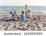 group of friends having beac...   Shutterstock . vector #1043955859