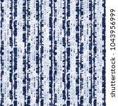 abstract folk striped bleached... | Shutterstock . vector #1043956999