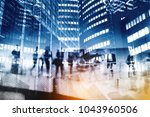 silhouettes of people walking... | Shutterstock . vector #1043960506