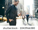 cheerful male trader dressed in ... | Shutterstock . vector #1043966380