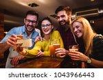 friends at the bar drinking... | Shutterstock . vector #1043966443
