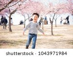 cherry blossoms and a smiling...   Shutterstock . vector #1043971984