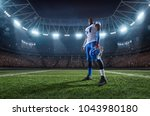 american football player in... | Shutterstock . vector #1043980180