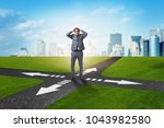 young businessman at crossroads ...   Shutterstock . vector #1043982580