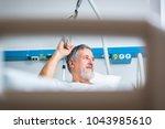 senior male patient in a modern ... | Shutterstock . vector #1043985610