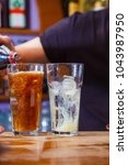 alcohol drink on bar. cocktail | Shutterstock . vector #1043987950
