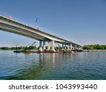 construction of a bridge over... | Shutterstock . vector #1043993440