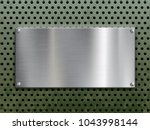 polished steel plate with... | Shutterstock .eps vector #1043998144