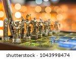 elegante chess board with brass ...   Shutterstock . vector #1043998474