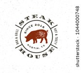 vintage steak house logo. retro ... | Shutterstock .eps vector #1044000748