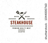 vintage steak house logo. retro ... | Shutterstock .eps vector #1044000760