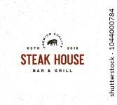 vintage steak house logo. retro ... | Shutterstock .eps vector #1044000784