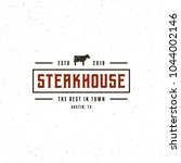 vintage steak house logo. retro ... | Shutterstock .eps vector #1044002146