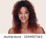 face of a successful woman with ...   Shutterstock . vector #1044007363