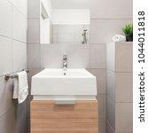 beige bathroom with modern... | Shutterstock . vector #1044011818