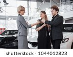 now her dream comes true. car... | Shutterstock . vector #1044012823