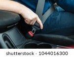 men's hand fastens the seat... | Shutterstock . vector #1044016300