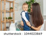 family at home relaxing | Shutterstock . vector #1044023869