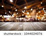 closeup top wood table with... | Shutterstock . vector #1044024076
