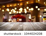 closeup top wood table with... | Shutterstock . vector #1044024208