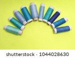 blue sewing thread on a yellow... | Shutterstock . vector #1044028630