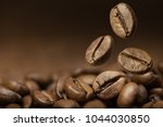 brown roasted coffee beans... | Shutterstock . vector #1044030850