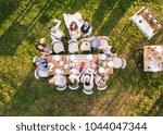 wedding reception outside in... | Shutterstock . vector #1044047344