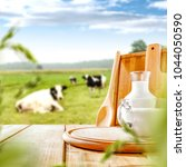 fresh milk on wooden desk and... | Shutterstock . vector #1044050590