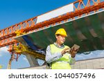 male architect or engineer... | Shutterstock . vector #1044057496