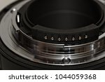 Small photo of The flange of a current F-mount bayonet lens, including aperture lever and CPU contacts