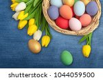easter eggs on meadow in... | Shutterstock . vector #1044059500