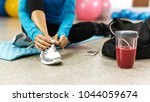woman tying shoelace before... | Shutterstock . vector #1044059674