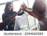 successful team.asian people... | Shutterstock . vector #1044060283